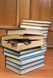 Two piles of old books and glasses Stock Photos