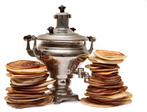 Two piles of pancakes and samovar  on Stock Image