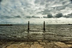 Two seagulls sitting on two pillars Stock Images