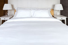 Two pillow on bedroom with white bed sheet and lamp Royalty Free Stock Photos