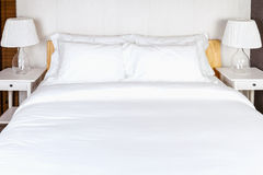 Two pillow on bedroom with white bed sheet and lamp Royalty Free Stock Images