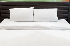 Two pillows on bed stock images