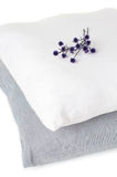 Two pillows and a branch of flowers Royalty Free Stock Photography