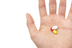 Two pills on the palm Stock Images
