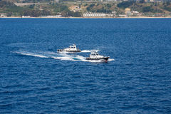 Two Pilot Boats Circling in Blue Water Royalty Free Stock Photography