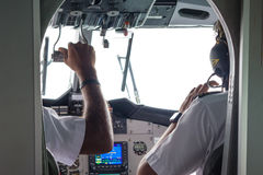 Two pilots in the cockpit of the sea plane Royalty Free Stock Image