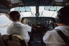 Two pilots inside propeller plane Royalty Free Stock Image