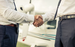 Two pilots shaking hands before flight Stock Photography