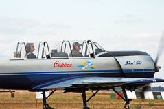 Two pilots sit in the sports plane and look into the distance Royalty Free Stock Images