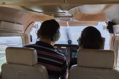 Two pilots sitting in a cockpit of cessna skyhawk 172 airplane. Stock Photo