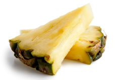 Two pineapple triangles with skin isolated. Royalty Free Stock Photo