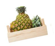 Two pineapples in crate Stock Photos