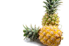 Two Pineapples. One ripe pineapple and one riprening fruit Stock Photo