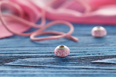 Two ping bead on blue table Stock Photos