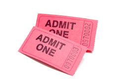 Two pink admission tickets on white. A stack of two admission tickets on a white background stock image