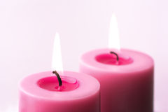 Two pink candles Stock Photo