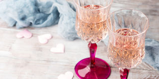 Two pink champagne glasses for romantic date. Banner Royalty Free Stock Image