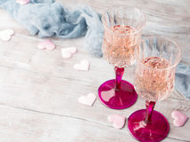Two pink champagne glasses for romantic date Royalty Free Stock Photo