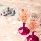 Two pink champagne glasses romantic date toned card Royalty Free Stock Photos