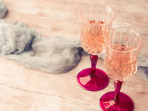 Two pink champagne glasses romantic date toned card Stock Image
