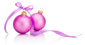 Two pink Christmas ball with ribbon bow Isolated on white backgr Stock Photos