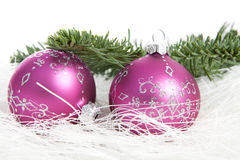 Two pink Christmas balls and pine tree over white background Royalty Free Stock Photography