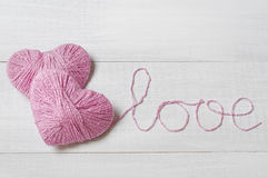 Two pink clews in shape of heart Royalty Free Stock Photo
