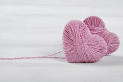 Two pink clews in shape of heart Stock Image