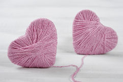 Two pink clews in shape of heart Royalty Free Stock Image