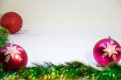 Two pink festive balloons out of focus with a red ball in the corner in focus. Festive, Christmas card,two vertical pink balls, and Christmas decorations on a Royalty Free Stock Photos