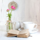 Two Pink Flowers Ranunculus And Old Opening Book Stock Image