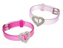 Two pink girlish braceletes Royalty Free Stock Image