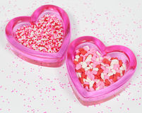 Two Pink Glass Hearts with Valentine's Sprinkles Royalty Free Stock Photography
