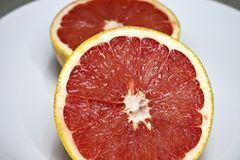 Two pink grapefruit halves royalty free stock image