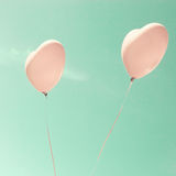 Two Pink Heart-shaped balloons Stock Photography