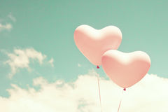 Two pink heart shaped balloons Royalty Free Stock Photo