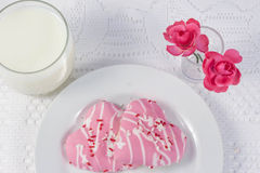 Two pink heart shaped cookies Royalty Free Stock Photo