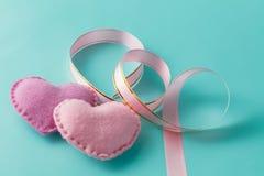 Two pink hearts on aquamarine background Royalty Free Stock Image
