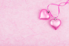 Two pink hearts on tissue paper Stock Photo