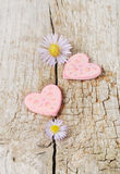 Two pink hearts on wooden background Royalty Free Stock Image