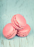 Two pink macaroons on wooden blue background Royalty Free Stock Image