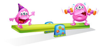 Two pink monsters playing with the seesaw Royalty Free Stock Photo