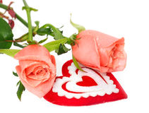 Two pink roses and heart on white Royalty Free Stock Photo