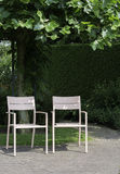 Two pink seats in garden stock photography