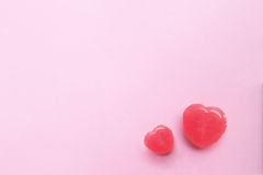 Two Pink Valentine`s day heart shape candy on empty pastel pink paper background. Love Concept. top view. Minimalism colorful Stock Photo