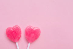 Two Pink Valentine`s day heart shape lollipop candy on empty pastel pink paper background. Love Concept. top view. Royalty Free Stock Image
