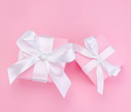 Two Pink Valentines Day gift box tied white ribbon stock photo