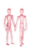 Two pink wooden little people Royalty Free Stock Image