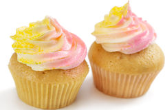 Two pink and yellow cupcake, on white Stock Photos