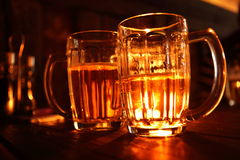 Two pint of beer. On a table stock images